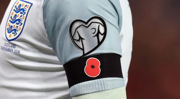 All four home nations were fined by FIFA last year for wearing poppies in international matches