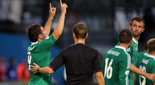 Martin Paterson, left, celebrates scoring Northern Ireland's winner against Russia in 2013