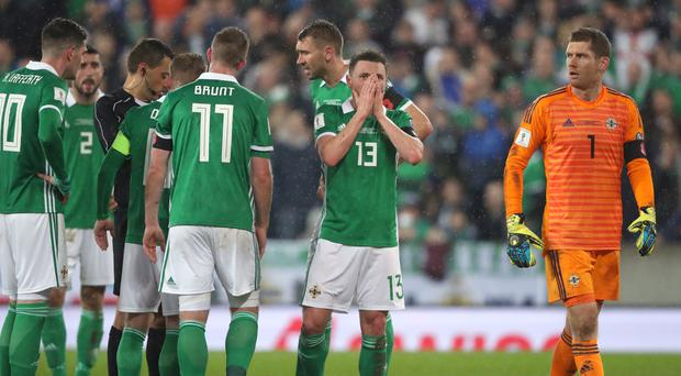 Northern Ireland's players react in disbelief after Corry Evans, centre, is adjudged to have handled