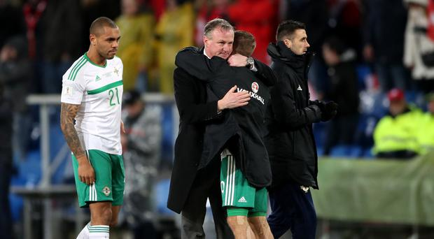 Michael O'Neill and Jamie Ward embrace after Northern Ireland's World Cup play-off with Switzerland