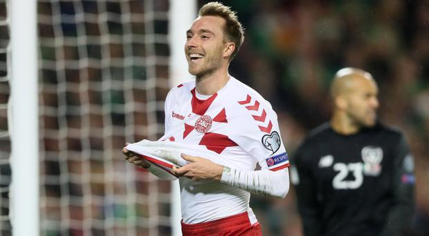 Christian Eriksen fired a treble as Denmark reached the World Cup finals
