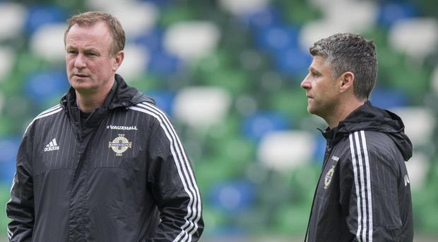 Michael O'Neill and Stephen Robinson, right, worked together with Northern Ireland