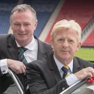 Michael O'Neill, pictured left, could be set to replace Gordon Strachan, right
