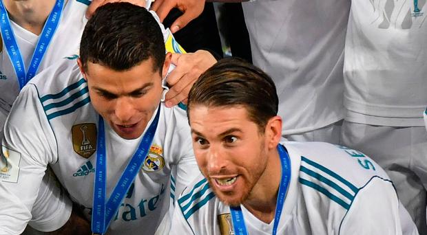 Top of the world: Real captain Sergio Ramos with the trophy