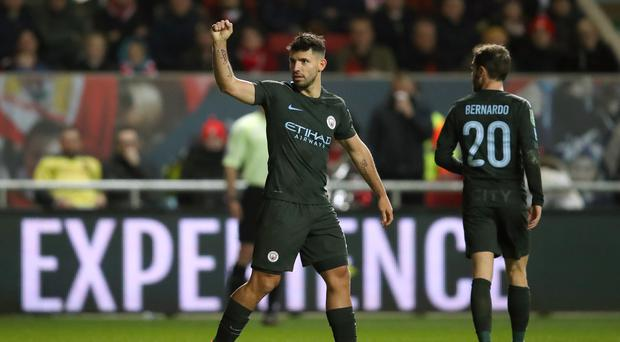 Sergio Aguero celebrates scoring Manchester City's second of the evening