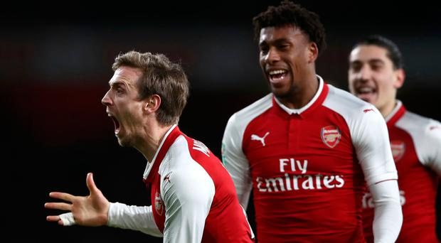 Turnaround: Nacho Monreal celebrates Arsenal's equaliser