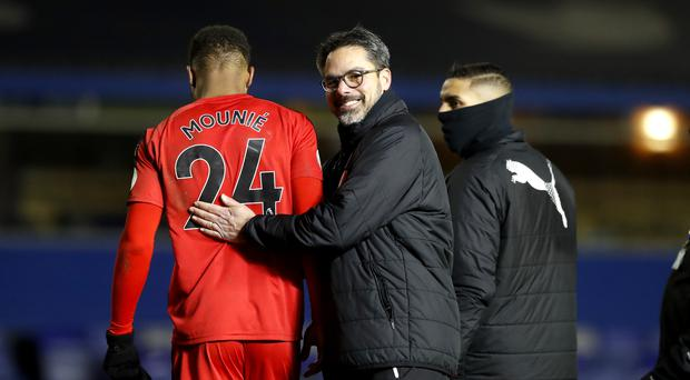 David Wagner congratulates goalscorer Steve Mounie at St Andrew's