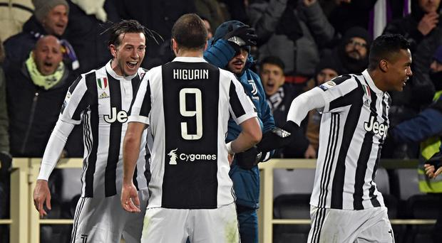 Juventus celebrate scoring against Fiorentina in a Serie A game