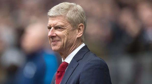 Arsene Wenger could afford a smile as Arsenal won