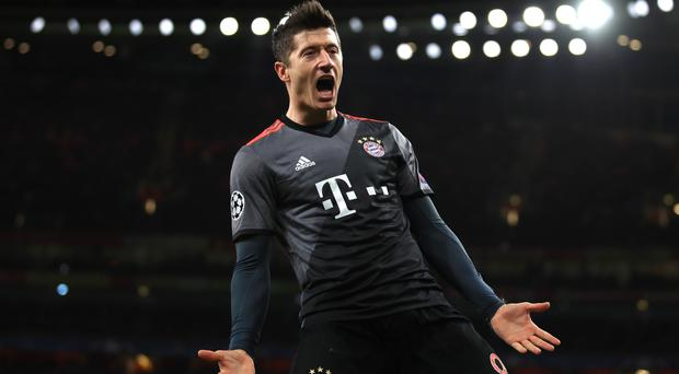 Robert Lewandowski scored a stoppage-time penalty to earn Bayern Munich victory at Wolfsburg
