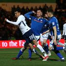 Tottenham's Dele Alli won a contested penalty in the 2-2 FA Cup draw at Rochdale .