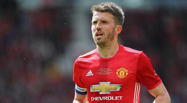 Manchester United's Michael Carrick insists the knockout phase of the Champions League should be a minimum for the club.