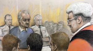 Court artist sketch showing victims looking on from the public gallery as the judge sentences Barry Bennell (Elizabeth Cook/PA)