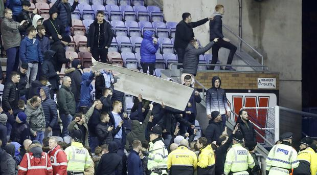 Fans rip down advertising boards after Wigan's FA Cup win over Manchester City