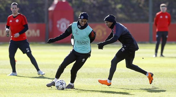 Manchester United's Marcus Rashford and Ashley Young (right) during the training session at the AON Training Complex (Martin Rickett/PA Wire)