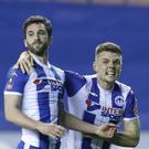 Will Grigg (left) scored the goal that knocked Manchester City out of the FA Cup