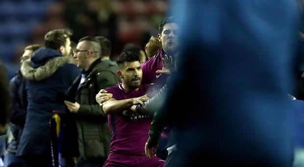 Manchester City's Sergio Aguero in an altercation with a pitch invader after the final whistle (Tim Goode/Empics)
