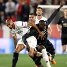 Sevilla's Steven Nzonzi, left, and Manchester United's Romelu Lukaku battle for the ball