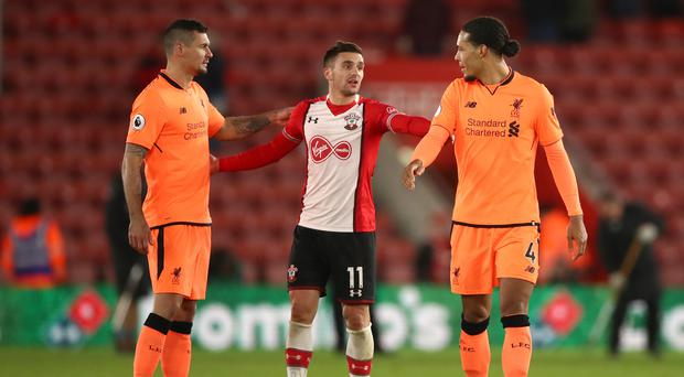 Liverpool defender Dejan Lovren (left) believes he and Virgil van Dijk (right) can benefit from each other.