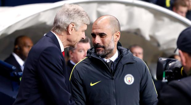 Arsene Wenger, left, feels football's laws provide enough protection for Pep Guardiola's Manchester City