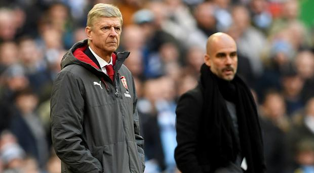Pep Guardiola, right, got the upper hand over Arsene Wenger at Wembley