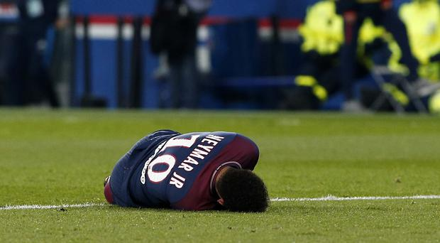 Neymar shows his distress after suffering an ankle injury against Marseille