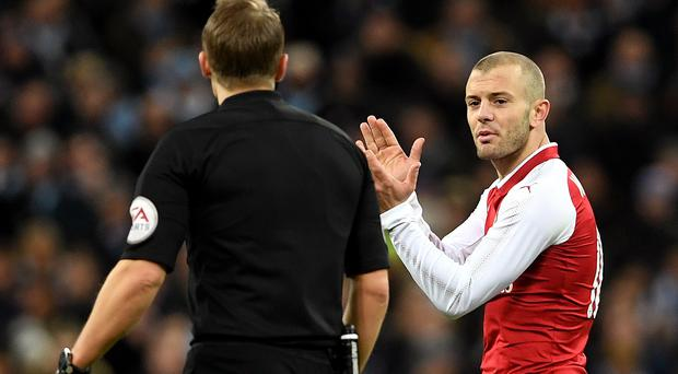 Jack Wilshere was unhappy with some of the refereeing decisions at Wembley