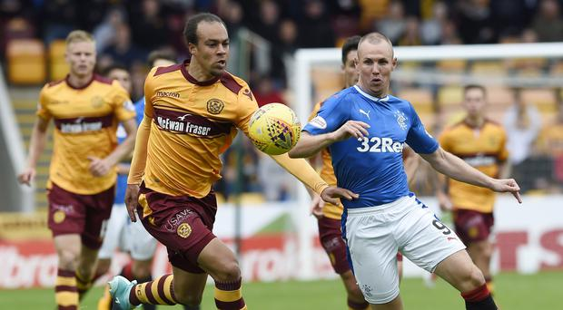 Motherwell's Charles Dunne, left, has been branded a