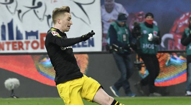 Marco Reus equalised for Borussia Dortmund as they drew 1-1 at Bundesliga rivals RB Leipzig