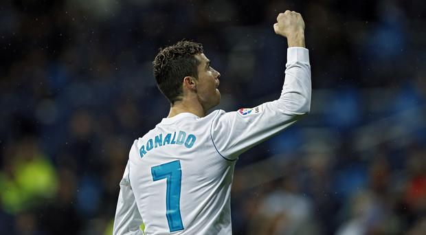 Cristiano Ronaldo passed a landmark of 300 LaLiga goals with two against Getafe (Francisco Seco/AP/Press Association Images)