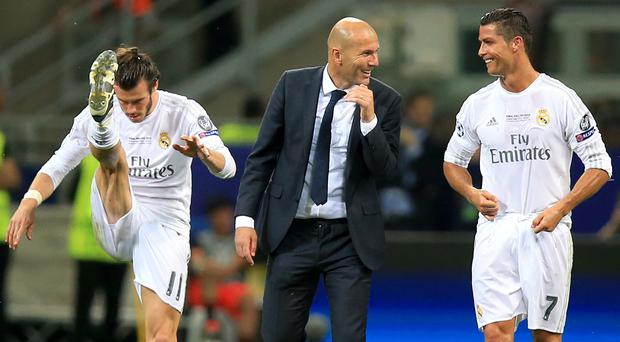 Real Madrid head coach Zinedine Zidane (centre) knows just how important Cristiano Ronaldo (right) is to the squad (Mike Egerton/EMPICS Sport)
