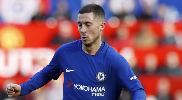 Chelsea's Eden Hazard is reportedly stalling on signing a new deal at the club (Martin Rickett/PA)