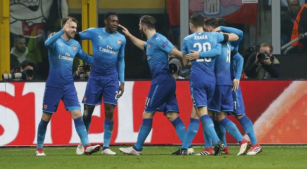 Aaron Ramsey, left, celebrates with his Arsenal team-mates after scoring