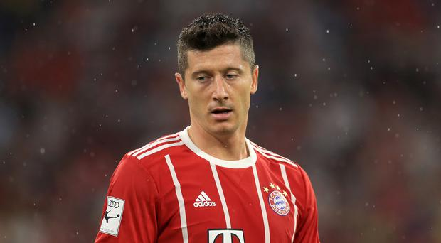 Robert Lewandowski grabbed a hat-trick as Bayern eased to victory