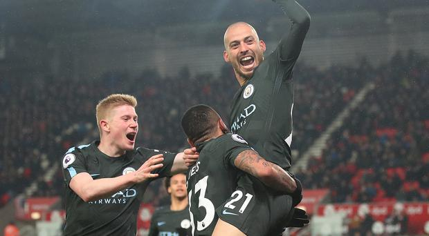 David Silva celebrates scoring his side's second goal
