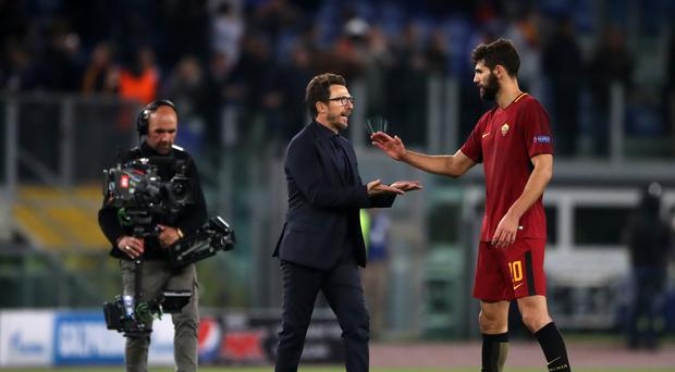 Roma coach Eusebio Di Francesco (centre) hailed his team after they secured a place in the quarter-finals of the Champions League (Nick Potts/EMPICS Sport)
