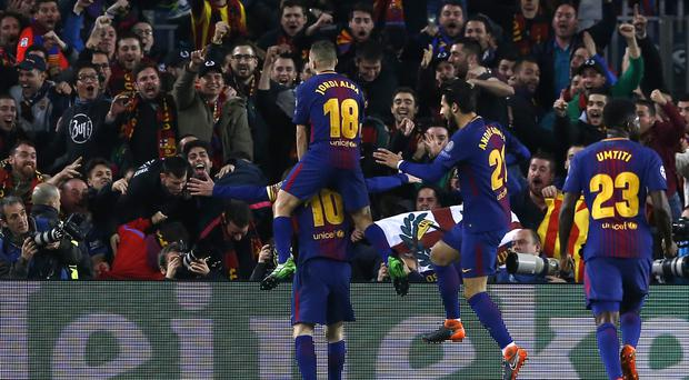 Lionel Messi, left, celebrates the third goal with his Barcelona team-mates