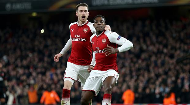 Danny Welbeck, right, bagged a brace to send Arsenal through
