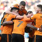 Benik Afobe is congratulated by his Wolves team-mates
