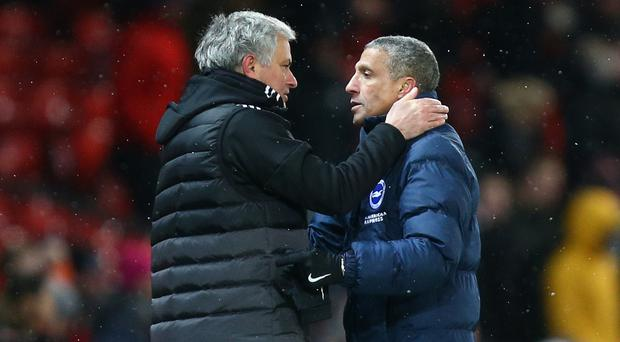 Jose Mourinho, left, saw his Manchester United side beat Chris Hughton's Brighton 2-0