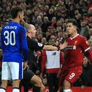 Mason Holgate (left) and Roberto Firmino clashed during an FA Cup tie