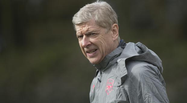 Arsene Wenger is hoping Arsenal win the Europa League to secure Champions League football