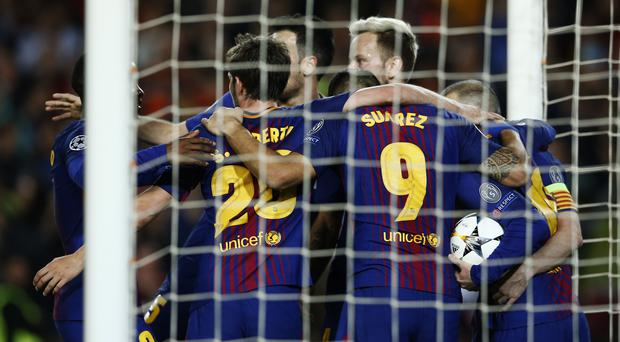 Barcelona's players celebrates the opening goal of their comfortable win over Roma