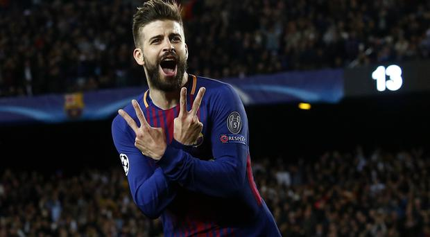 Gerard Pique celebrates scoring Barcelona's third goal against Roma