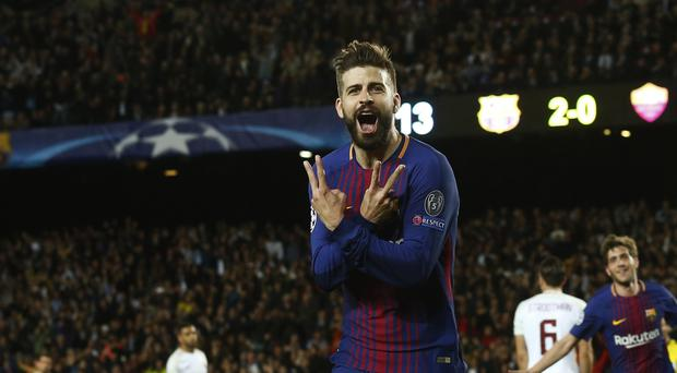 Barcelona's Gerard Pique celebrates after scoring the third goal against Roma