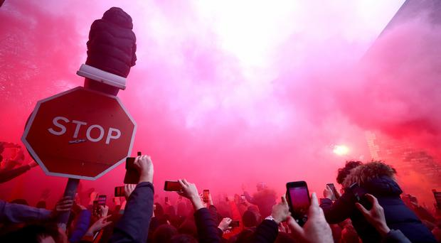 Flares were set off and missiles thrown at Manchester City's team coach ahead of their Champions League quarter-final against Liverpool at Anfield