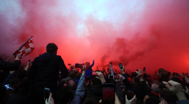 Supporters let off flares outside Anfield