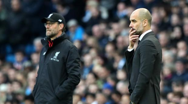 iverpool manager Jurgen Klopp, left, and Manchester City counterpart Pep Guardiola