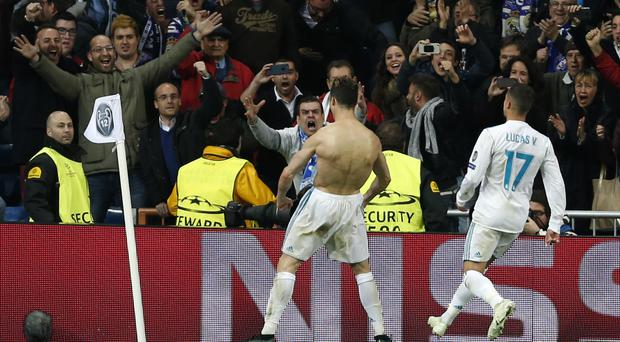 Real Madrid's Cristiano Ronaldo celebrates after scoring his match-winning penalty against Juventus