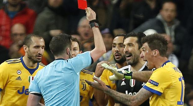 Juventus goalkeeper Gianluigi Buffon is shown a red card by referee Michael Oliver